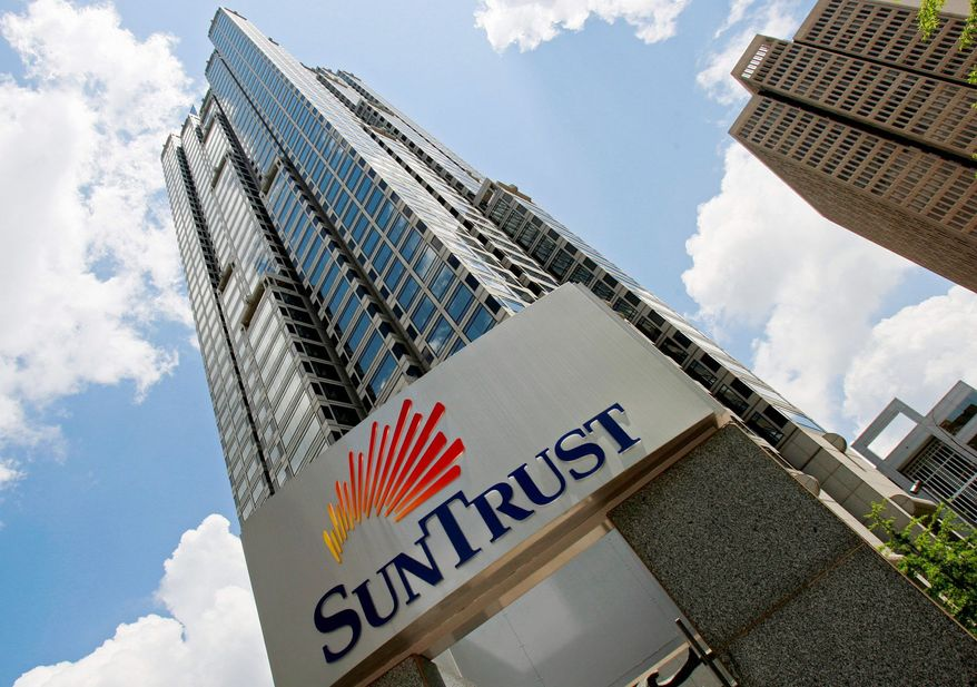 SunTrust Mortgage, a subsidiary of SunTrust Bank, has agreed to pay $21 million to resolve a suit in which the Justice Department claimed it increased interest rates and fees for qualified black and Hispanic borrowers. (Associated Press)