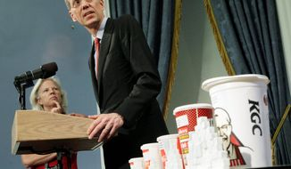 New York City Health Commissioner Thomas Farley, accompanied by Linda Gibbs, the deputy mayor for health and human services, discusses at New York's City Hall on Thursday, May 31, 2012, the proposal by Mayor Michael R. Bloomberg for a ban on the sale of large sodas and other sugary drinks in the city's restaurants, delis and movie theaters. (Associated Press)