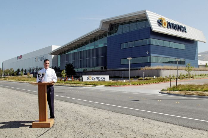 """Mitt Romney campaigns at the shuttered Solyndra plant in Fremont, Calif., on Thursday. """"It's a symbol not of success, but of failure,"""" he said of the company lauded by President Obama that received $535 million in government-backed loan guarantees. (Associated Press)"""