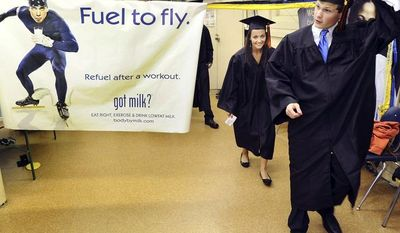 **FILE** Horizon High School seniors Daniel Odom and Sydney Priest leave the gym May 23, 2012, before their graduation in Decatur, Ala. (Associated Press/The Decatur Daily)