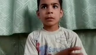 This image made from amateur video, released by the Houla Media Office and accessed May 31, 2012, purports to show 11-year-old Ali el-Sayed, a survivor of the Houla massacre that began Friday and left 108 people dead, many of them children and women. Houla is a collection of poor farming villages and olive groves in Syria's central Homs province. (Associated Press/Shaam News Network via AP video)