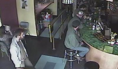 A frame grab provided by the Seattle Police Department shows a man (left) believed to be the suspect in a shooting at the Cafe Racer on Wednesday, May 30, 2012, in the University district of Seattle. (AP Photo/Seattle Police Department)