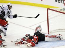 Los Angeles Kings' Anze Kopitar shoots a puck past New Jersey Devils goalie Martin Brodeur for the winning goal in overtime of Game 1 of the Stanley Cup Final on Wednesday, May 30, 2012, in Newark, N.J. (AP Photo/Frank Franklin II)