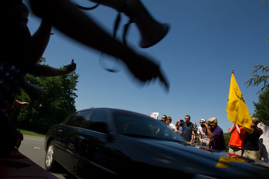 Protesters scream at a car as it turns into the entrance to the Marriott Westfields where the annual Bilderberg Conference is being held, Chantilly, Va., Thursday, May 31, 2012. The Bilderberg Conference is an annual meeting of highly influential people in private industry and public office from North America and Western Europe. (Andrew Harnik/The Washington Times)