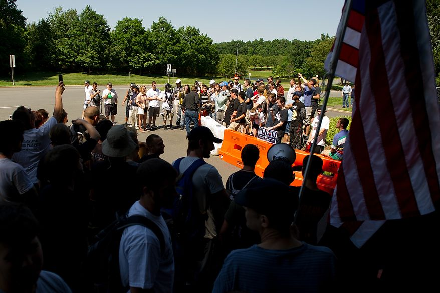 Protesters demonstrate at the entrance to the Marriott Westfields where the annual Bilderberg Conference is being held, Chantilly, Va., Thursday, May 31, 2012. The Bilderberg Conference is an annual meeting of highly influential people in private industry and public office from North America and Western Europe. (Andrew Harnik/The Washington Times)
