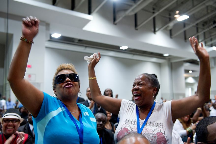 Priscilla Thompson, left, and her best friend Gwen West, who both credit Chuck Brown as the reason they got an education, cheer as Marion Barry takes the stage at the memorial service for D.C. Go-Go icon Chuck Brown Thursday, May 31, 2012 at the Washington Convention Center in Washington, The two women said they grew up on Go-Go. (Barbara L. Salisbury/The Washington Times)