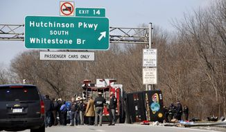 ** FILE ** In this March 12, 2011 photo, Emergency personnel investigate the scene of a bus crash on Interstate-95 in the Bronx borough of New York. Twenty-six bus operations that operated between New York and Florida have been closed for safety violations. (AP Photo/David Karp, File)