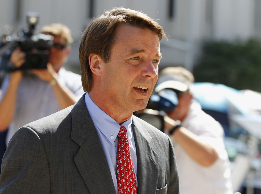John Edwards arrives at a federal courthouse during the eighth day of jury deliberations in his trial on charges of campaign corruption in Greensboro, N.C., Wednesday, May 30, 2012. The jury declared it was deadlocked on five of the six counts related to campaign finance violations. (AP Photo/Chuck Burton)