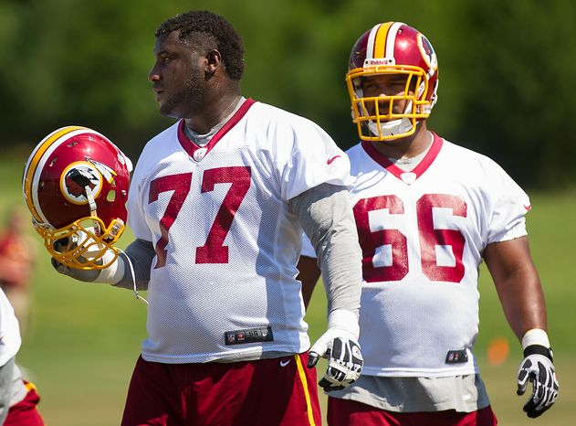 Washington Redskins tackle Jammal Brown (77), left, and Washington Redskins center Chris Chester (66), right, during an organized team activity at Redskins Park, Ashburn, Va., Thursday, May 31, 2012. (Andrew Harnik/The Washington Times)