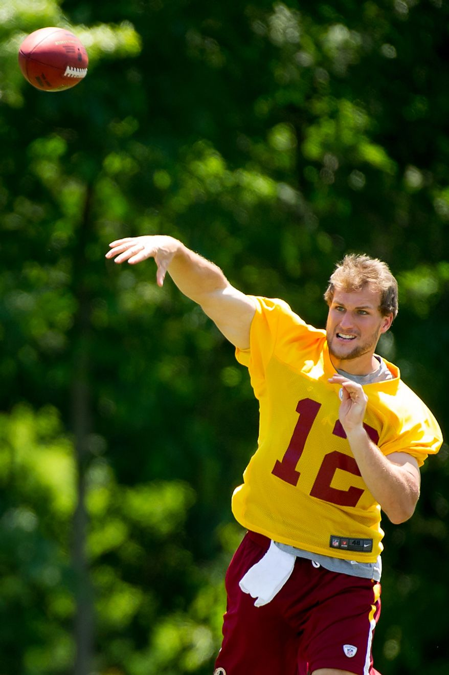 Washington Redskins quarterback Kirk Cousins (12) throws during offensive drills at an organized team activity at Redskins Park, Ashburn, Va., Thursday, May 31, 2012. (Andrew Harnik/The Washington Times)