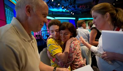 Nicholas B. Rushlow, 14, of Pickerington, Ohio, (center) is greeted by his mother Michelle and father Keith (left) after he and a handful of other contestants advanced to the championship round of the 2012 Scripps National Spelling Bee at the Gaylord National Resort and Convention Center in Oxon Hill, Md., Thursday, May 31, 2012. (Rod Lamkey Jr/The Washington Times)