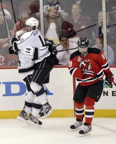 Los Angeles Kings' Anze Kopitar celebrates his overtime game-winning goal with teammate Justin Williams, who had the brilliant back-handed pass to spring the center for the breakaway. The Kings won Game 1 of the Stanley Cup Final 2-1. (AP Photo/Frank Franklin II)