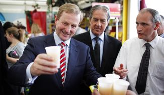 "Irish Prime Minister Enda Kenny takes a glass of apple juice at the Bord Bia Bloom festival in the Phoenix Park, Dublin, on June 1, 2012. Referendum officials compiling unofficial results say Ireland's voters have decided to ratify the European Union's deficit-fighting treaty with ""yes"" votes reaching nearly 60 percent. (Associated Press)"