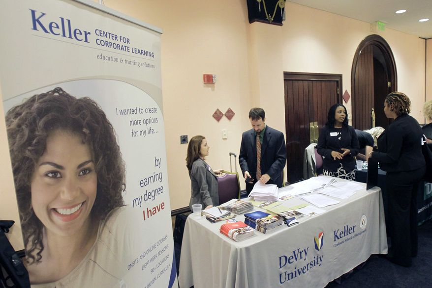 ** FILE ** In this May 30, 2012, photo, members of DeVry University and Keller Graduate School of Management speak to attendee's seeking to further their education during a career expo sponsored by Jobs Direct USA in Orlando, Fla. (AP Photo/John Raoux)