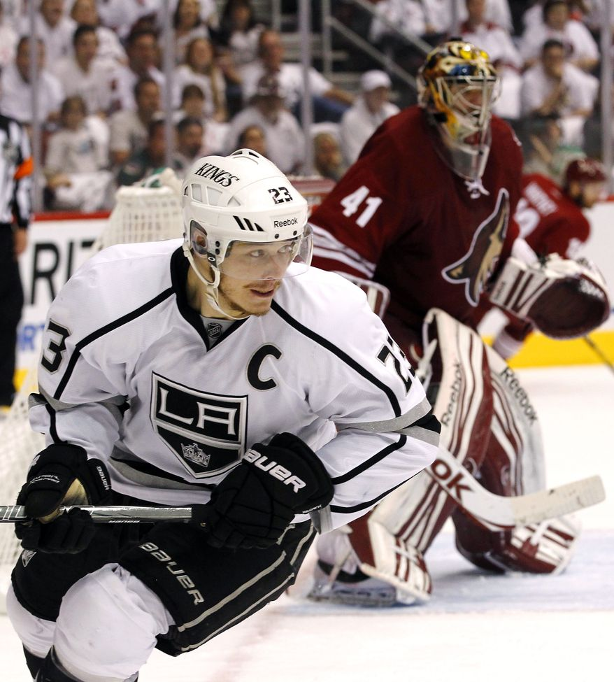 Captain Dustin Brown is looking to lead the eighth-seeded Los Angeles Kings to the Stanley Cup. If he does it, he would become the second American-born captain to do so. Brown was born in Ithaca, N.Y. (AP Photo/Ross D. Franklin, File)