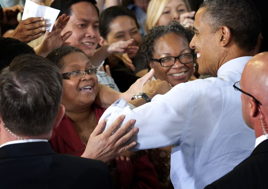 Minneapolis Superintendent of Schools Bernadeia Johnson (left) shakes hands June 1, 2012, with President Obama as he greets supporters at Honeywell Automation and Control Solutions Global Headquarters in Golden Valley, Minn., where he spoke about jobs for veterans. (Associated Press/The Star Tribune)