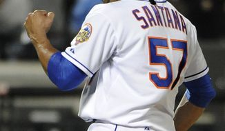 New York Mets starting pitcher Johan Santana celebrates his no-hitter against the St. Louis Cardinals on Friday, June 1, 2012, at Citi Field in New York. The Mets won 8-0. (AP Photo/Kathy Kmonicek)