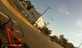 A helmet-cam video posted on YouTube shows a driver yelling out of his truck's passenger-side window at a cyclist as he rides down Rhode Island Avenue Northeast before the cyclist tumbles to the road.