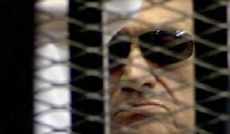 In this video image taken from Egyptian State Television, 84-year-old former Egyptian president Hosni Mubarak is seen in the defendant's cage as a judge reads the verdict in on charges of complicity in the killing of protesters during last year's uprising that forced him from power, in Cairo, Egypt, Saturday, June 2, 2012. Egypt's ex-President Hosni Mubarak has been sentenced to life in prison after a court convicted him on charges of complicity in the killing of protesters during last year's uprising that forced him from power. (AP Photo/Egyptian State TV)