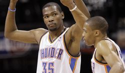 Oklahoma City Thunder's Kevin Durant (35) and Russell Westbrook celebrate after a play against the San Antonio Spurs during the second half of Game 4 of the Western Conference final Saturday, June 2, 2012, in Oklahoma City. (AP Photo/Sue Ogrocki)