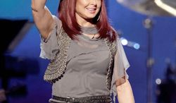 """** FILE ** In this April 4, 2011 photo, country singer Naomi Judd performs at the Girls' Night Out: Superstar Women of Country in Las Vegas. Judd is hosting a limited-run talk show on SiriusXM called """"Think Twice."""" Her first guest will be Ashley Judd, June 8. (AP Photo/Julie Jacobson, file)"""