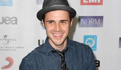 "** FILE ** This May 10, 2012 file photo shows singer Kris Allen, season eight winner of the singing competition series ""American Idol,"" at NARM Music Biz 2012 Awards in Century City, Calif. Allen's second album ""Thank You Camellia"" was released last month. (AP Photo/Katy Winn)"