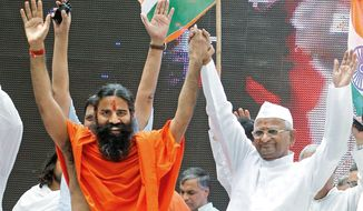 Baba Ramdev (left), an Indian yoga guru, and Anna Hazare, an Indian anti-corruption crusader, greet supporters during a fast in New Delhi on Sunday. The Indian anti-corruption campaigners held a daylong protest to press the government to act against widespread graft and bring back hundreds of billions of dollars stashed overseas. (Associated Press)
