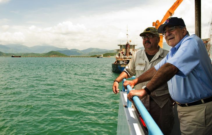 U.S. Secretary of Defense Leon E. Panetta (right) talks with Chief Mate Fred Cullen as he takes a boat out to the USNS Richard E. Byrd in Cam Ranh Bay, Vietnam, on Sunday, June 3, 2012. (AP Photo/Jim Watson, Pool)