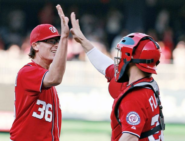 Tyler Clippard (left), an All-Star set-up man in 2011, is perfect in four save opportunities since replacing Henry Rodriguez. Jesus Flores, who homered in Saturday's win, has become the everyday catcher with Wilson Ramos out for the season. Flores has had to overcome shoulder injuries that derailed his career for three seasons. (Associated Press)