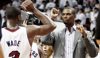 """The Miami Heat are just 5-4 since Chris Bosh (right) suffered an abdominal strain against Indiana in the Eastern Conference semifinals May 13. His status has been up graded to """"day to day."""" (Associated Press)"""