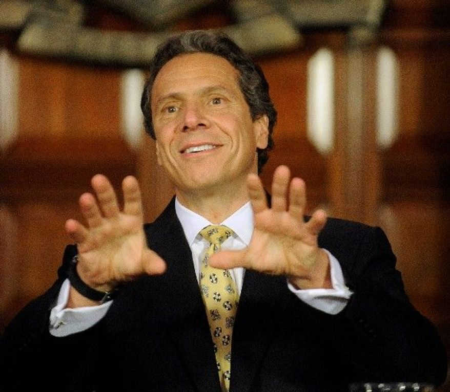 New York Gov. Andrew Cuomo discusses the decriminalization of the possession of small amounts of marijuana in Albany, N.Y., on Monday. (Associated Press)