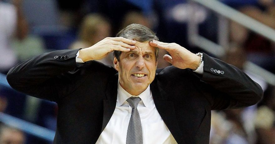 Randy Wittman and the Washington Wizards hold the No. 3 pick in the draft as they look to improve on their 20-46 record of last season. (Associated Press)