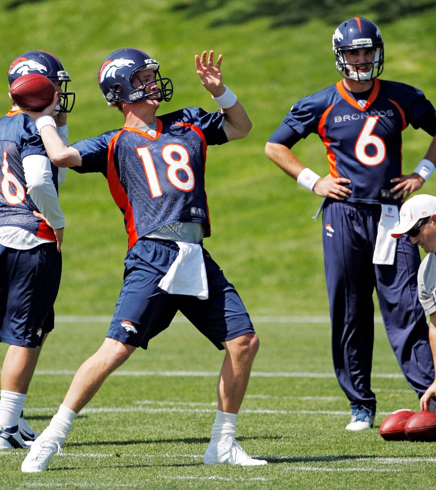 Peyton Manning threw deep passes Monday with no difficulty. He sat out the 2011 season with Indianapolis while recuperating from multiple neck surgeries. (Associated Press)