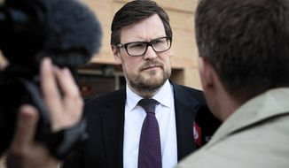 Defense lawyer Kaare Traberg Smidt speaks to media outside court in Glostrup, Denmark, on Monday, June 4, 2012, after four men who planned a terror spree at the office of a Danish newspaper that published cartoons of the Prophet Muhammed were found guilty on Monday and sentenced each to 12 years in prison. (AP Photo/POLFOTO, Jakob Joergensen)