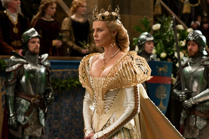 """This undated image released by Universal Pictures shown actress Charlize Theron in a scene from """"Snow White and the Huntsman."""" Theron's costume was designed by Academy Award-winn"""