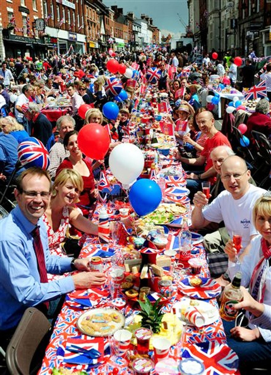 A street party to commemorate the Queen's Diamond Jubilee at Ashby De La Zouch, central England to celebrate Queen Elizabeth's 60 years on the throne. (AP Photo/Rui Vieira/PA)