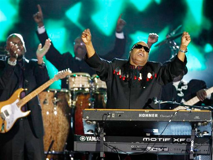 Stevie Wonder performs at the Queen's Jubilee Concert in front of Buckingham Palace, London, Monday, June 4, 2012. The concert is a part of four days of celebrations to mark the 60 year reign of Britain's Queen Elizabeth II. (AP Photo/Joel Ryan)