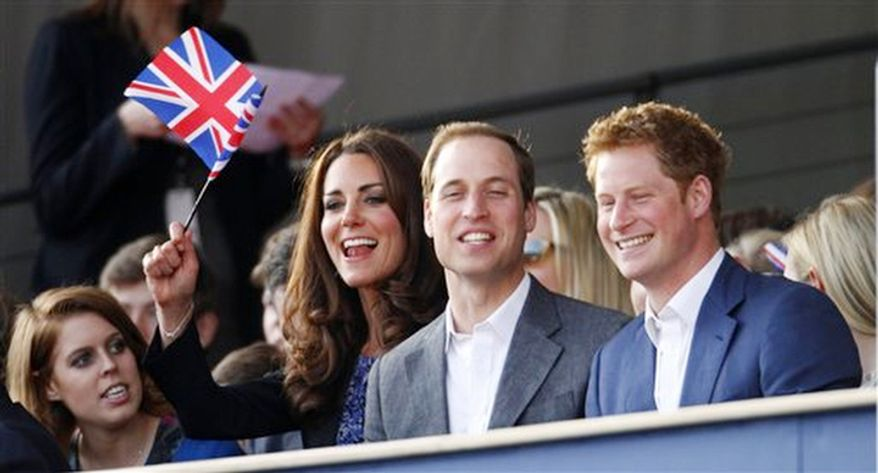 The Duke and Duchess of Cambridge with Prince Harry, right,  attend the Diamond Jubilee concert in London Monday June 4, 2012.  (AP Photo / Dave Thompson, Pool)