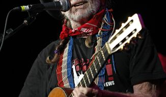 "**FILE** Country singer Willie Nelson performs Oct. 17, 2011, during ""Fire Relief, The Concert For Central Texas"" at the Frank Erwin Center in Austin, Texas. (Associated Press)"