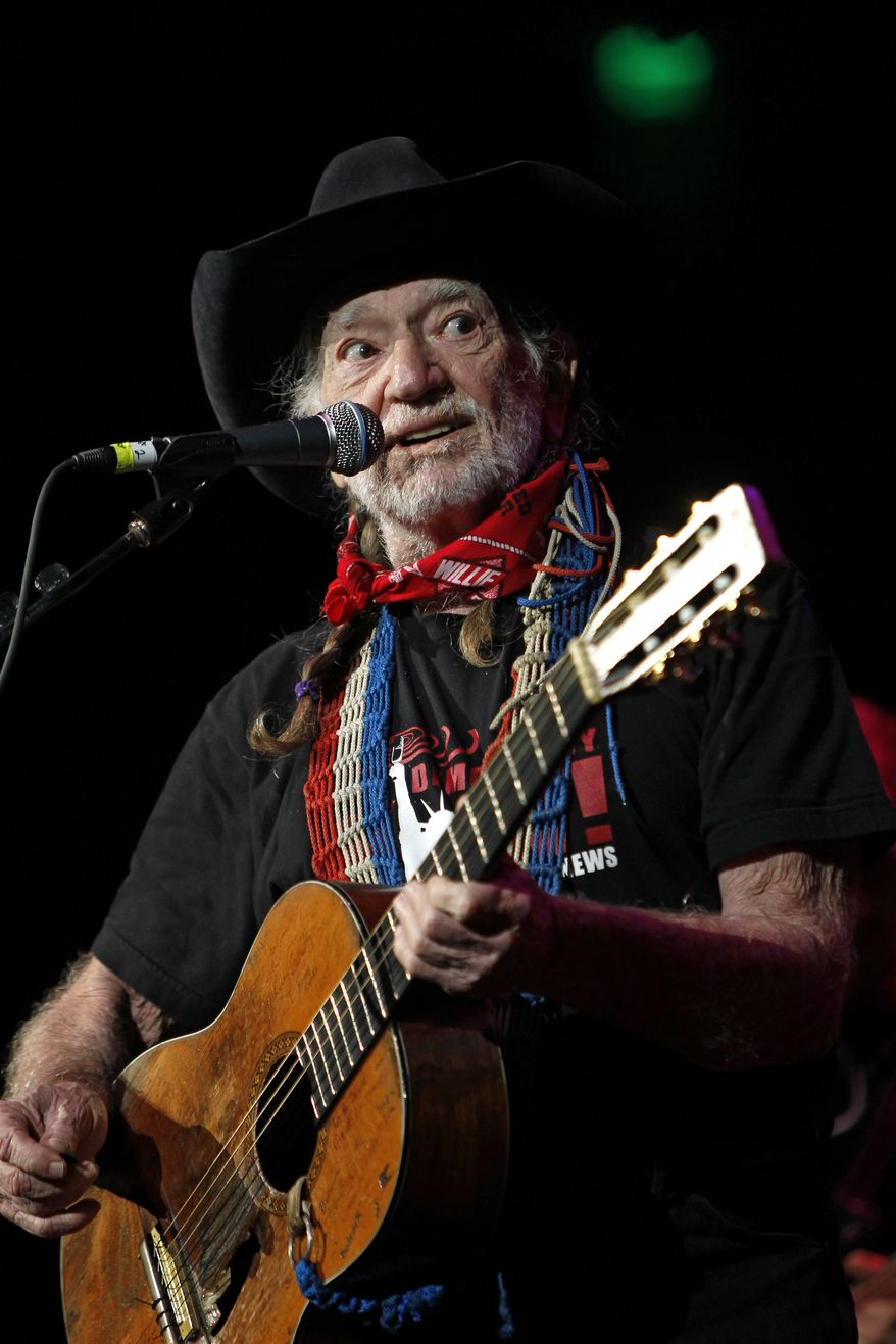 """**FILE** Country singer Willie Nelson performs Oct. 17, 2011, during """"Fire Relief, The Concert For Central Texas"""" at the Frank Erwin Center in Austin, Texas. (Associated Press)"""