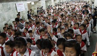 North Korean students who were selected as delegates to the Korean Children's Union tour a subway station in Pyongyang, North Korea, on Sunday, June 3, 2012. (AP Photo/Jon Chol Jin)