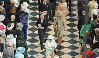 Britain's Queen Elizabeth II and the royal family depart St. Paul's Cathedral following a service of thanksgiving to begin the final day of Diamond Jubilee celebrations on Tuesday. (Associated Press)