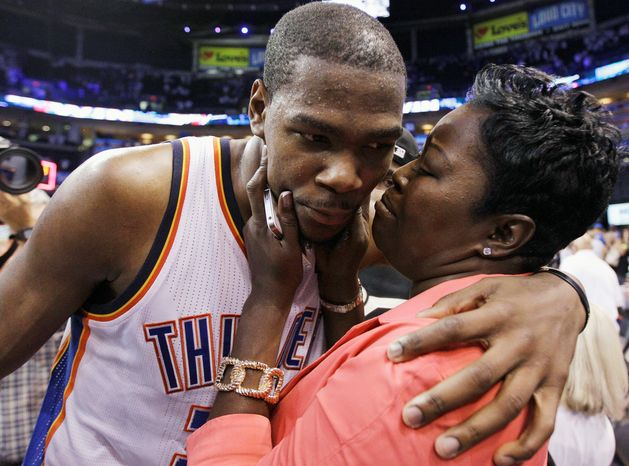 Oklahoma City's Kevin Durant has a kiss for his mother, Wanda Pratt, after Thunder games. Family members are always uppermost in his thoughts; Durant dedicated the Thunder's win Monday to an ailing uncle. (Associated Press)
