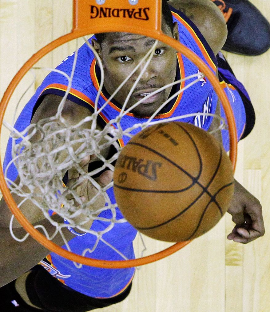 District native Kevin Durant scored 27 points in Oklahoma City's 108-103 win over San Antonio in Game 5 of the Western Conference finals Monday. Durant is averaging 27.4 points in 14 playoff games. (Associated Press)