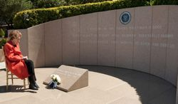 Nancy Reagan on Tuesday observes the eighth anniversary of the passing of President Reagan after placing flowers at his grave site at the Ronald Reagan Presidential Library in Simi Valley, Calif. Reagan died June 5, 2004, at age 93. (Ronald Reagan Presidential Foundation)