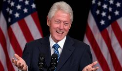Former President Bill Clinton speaks at a Democratic fundraiser in New York. He later told CNBC he favors keeping tax cuts for all income levels. (Associated Press)