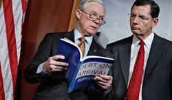 "**FILE** Having labeled it ""Debt on Arrival,"" Republican Sens. Jeff Sessions (left) of Alabama, the Senate Budget Committee's ranking member, and John Barrasso of Wyoming react to President Obama's fiscal 2013 federal budget on Feb. 13, 2012, during a news conference on Capitol Hill. (Associated Press)"