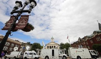 Television satellite trucks set up June 4, 2012, outside the Centre County Courthouse in Bellefonte, Pa., in preparation for the start of the child sexual abuse trial of former Penn State college football assistant coach Jerry Sandusky. (Associated Press)