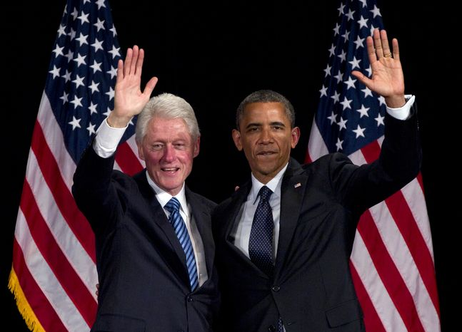 ** FILE ** Former President Bill Clinton and President Obama wave to the crowd during a campaign event at the Waldorf Astoria on Monday, June 4, 2012, in New