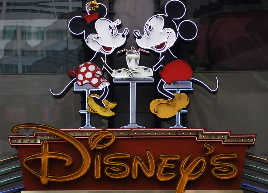 ** FILE ** In this Feb. 6, 2012 photo, the Disney Soda Fountain & Studio Store marquee is seen on Hollywood Boulevard in Los Angeles. The Walt Disney Co. said Tuesday, June 5, 2012, its programming will no longer be sponsored by junk food, becoming the first major media company to ban such ads for its TV channels, radio stations and websites intended for children. (AP Photo/Damian Dovarganes)